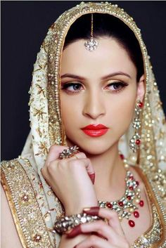 Gorgeous Pakistani bridal. Love how the lip coordinates w/ the red in the dress.
