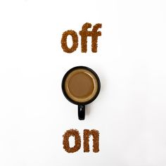 Off/On spelled out in ground coffee and a coffee cup in the middle with the handle pointing to the on.