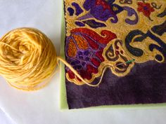 Needle felting into fabric with yarn