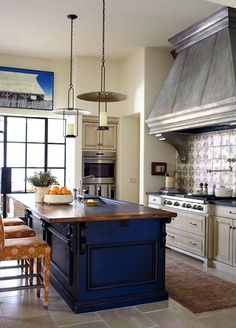 Charming and timeless details in an Arizona vacation home  I absolutely love love the island color!!