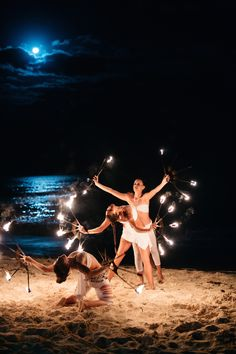 During the evening, fire dancers performed beneath an enchanting full moon. #weddingentertainment #moonlight #firedancers Photography: Stephen Karlisch. Read More: http://www.insideweddings.com/weddings/elegant-beachside-destination-wedding-in-playa-del-carmen-mexico/663/