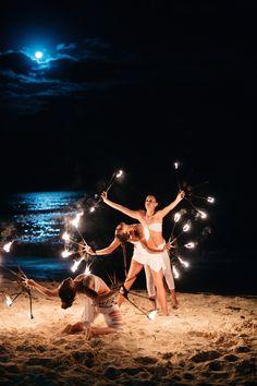 During the evening, fire dancers performed beneath an enchanting full moon. #weddingentertainment #moonlight #firedancers Photography: Stephen Karlisch. Read More: http://www.insideweddings.com/weddings/elegant-beachside-destination-wedding-in-playa-del-carmen-mexico/663/