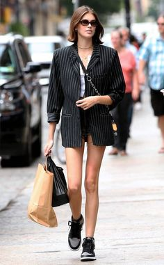 Kaia Gerber from The Big Picture: Today's Hot Photos NYC summer! The model does some shopping in Soho, NYC sporting a pin stripe blazer and sneakers. Kaia Gerber, Kaia Jordan Gerber, Meagan Good, Bermuda Jeans, New York Street Style, Jeans Boyfriend, Models Off Duty, Striped Blazer, Female Models