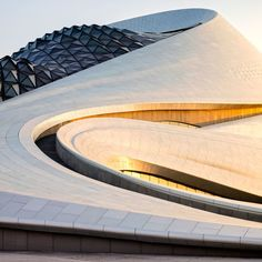 Designed by MAD Architects, the Harbin Opera House in northern China features a sculptural lobby with timber-clad balconies and stairs.