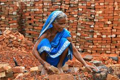 A woman working with bricks in Dhaka, Bangladesh.