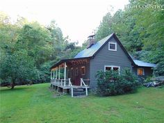 Love the setting! Circa 1931. Over one acre in the NC mountains! $139,900 - The Old House Life Rocking Chair Front Porch, Nc Mountains, Brick Flooring, Picnic Area, Cozy Place, Brick Fireplace, Property Search, Hearth