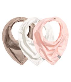 Light pink. Lined triangular scarves in soft cotton jersey with adjustable snap…