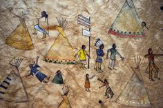 Painting on buffalo skin of Sand Creek Massacre; Chief Black Kettle is shown under the US flag and a white flag indicating peacefulness. Description from bscrittersitter.blogspot.co.il. I searched for this on bing.com/images