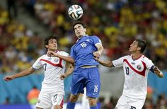Greece's Lazaros Christodoulopoulos, middle, heads the ball between Costa Rica's Yeltsin Tejeda (17) and Bryan Ruiz during the World Cup round of 16 soccer match between Costa Rica and Greece at the Arena Pernambuco in Recife, Brazil, Sunday, June 29, 2014.