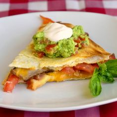 Steak, cheddar and tomato quesadillas with spicy lime tomato guacamole.