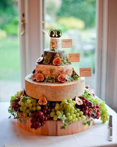 """A """"cake"""" of cheese wheels topped with perfect silhouettes of the bride and groom"""