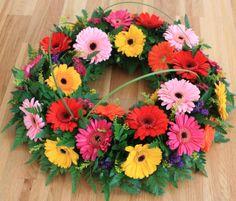 Funeral tribute of colourful gerberas - Modern Funeral Arrangements, Flower Arrangements, Altar Flowers, Funeral Tributes, Floral Wreath, Flower Wreaths, Memorial Flowers, Sympathy Flowers, Funeral Flowers