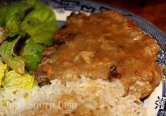 Country Style Pork Chops in Gravy:  Bone-in pork chops, dredged in seasoned flour, pan fried and finished in gravy.