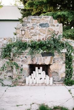 FOR THE CEREMONY || Stone fireplace with candlelight & cascading foliage as the backdrop || NOVELA BRIDE...where the modern romantics play & plan the most stylish weddings... www.novelabride.com @novelabride #jointheclique