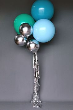 modern party balloons. Love these silver metallic balloons.