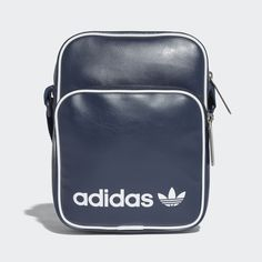 With throwback style and fresh features, this faux leather mini bag carries time-honoured adidas heritage into the present day. It has a contrast linear Trefoil logo and piping for a classic look. Stash your phone, tablet or other items in two compartments protected by zips.