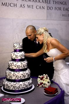 Attn Kayla. aka Myself. Black, white and purple 4 tier wedding cake. add some skulls too it or spider webbing. could also do just a light purple cake with black scrolls.