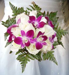 White roses and purple/magenta orchids except mine are going to be blue not purple