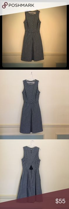 """J. CREW OO Blue White Pinstripe Sleeveless Dress Sleeveless dress has cross-over style at back.  Hook/eye closure at back of neck.  Zipper entry on lower portion of dress at back.  On-seam hand pockets.  Center kick pleat at front.  Bodice and skirt lined in navy muslin.  Bust: 32"""".  Length: 34"""" from top of shoulder.  100% Cotton with 100% Cotton lining.  Smoke-free. J. Crew Dresses"""