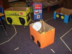 Box cars for transportation unit- I taped roads down all over my classroom. I made these box cars out of used boxes, paint, construction paper, paper plates, and rope. I teach preschoolers, but if you have older kids they could make their own!