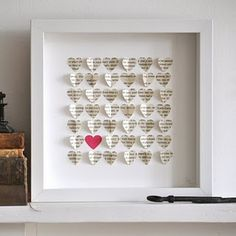 Hearts, shadow box, art, papercraft.-this would be cute to do with out favorite books and or sheets of music from our song