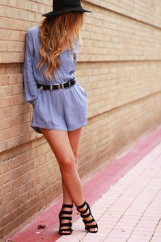Bohemian fall transition outfit styled with a grey long sleeve romper, strappy block heels, and sude chocker