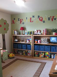 Great ideas for playroom walls. Love the open shelf and top, hidden storage in the middle and open but contained storage on the bottom!