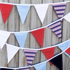 My first sewing project!  Simple fabric bunting flags - includes FREE printable instructions and flag template.