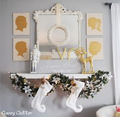 Like the gold silhouettes in general. Also the gold and white for holidays.  Elegant Christmas Mantel - Neutrals and Metallics #gold #silver #Christmas
