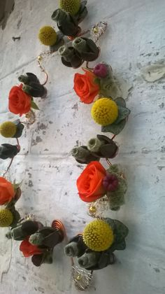 using rolling, grouping and contrasting forms o make a floral necklace - L Barnes