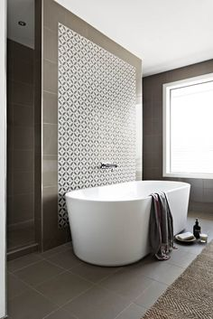 Aspire Home. Ensuite with walk through shower, freestanding bath and stone mosaic.