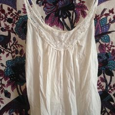 White American Eagle Outfitters tank top White American eagle outfitters tank top with floral design. Pictured with a belt above. This tank top has hardly been worn, but is very nice! Size x-small but fits like a small. American Eagle Outfitters Tops Tank Tops