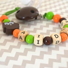 Pacifier clip beaded pacifier clip pacifier by orangeandcoco, $20.00 Boy Pacifier, Pacifier Clips, Pacifier Holder, Baby Keepsake, Babies Stuff, Child Safety, Paint Designs, Wooden Beads, Baby Love