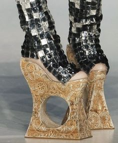 I suppose, if your name is LADY GAGA You'd be Inclined to Wear One of These Sky High Clogs of Art {Medieval Torture Device} By Designer Guo Pei.