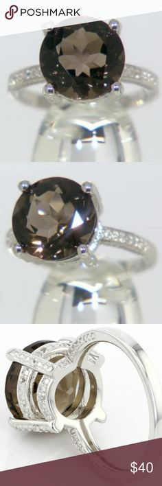 5.60ct Round Smoky Quartz Sterling Silver Ring 5.60ct Round Smoky Quartz and .06ctw Round White Topaz Sterling Silver Ring  ***deep chocolate colored smoky quartz stone that is stunning not only in size but also in the color it exhibits as it reflects any light***  Specifics: Ring Size: 7 Band marked/stamped: .925  Smoky Quartz Dimensions: 12mm Smoky Quartz stone is faceted Smoky Quartz stone is a natural Brazilian Quartz Accent Stones: 14 White Topaz Accent Stone Weight: .06 ctw Jewelry…