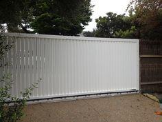 aluminium slat style sliding gate powdercoated white