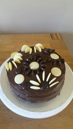 Homemade cake with chocolate icing, minstrels and milky bar buttons.
