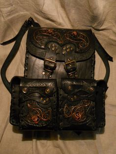 A leather backpack with copper ornament by ChanceZero.deviantart.com