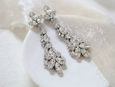 Art deco vintage style Swarovski crystals Bridal earrings- Handcrafted with CRYSTALLIZED™ - Swarovski Elements stones in rhodium finish setting.- Each stone is set by hand in my studio- Swarovski clear stones- Rhodium finish- Earrings measure 2.25 inches x .75 inch- Handcrafted in the US.- Nickel free and hypoallergen Statement Earrings, Diamond Earrings, Pearl Earrings, Vintage Fashion, Vintage Style, Bridal Earrings, Swarovski Crystals, Stone, Sirens