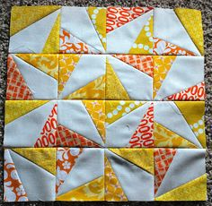 """A very cheerful piece from City Stitches blog. I have the Deb Tucker """"spotlight"""" ruler which would make this block a snap to piece!"""