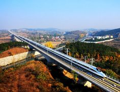 High-Speed Rail In The US? The United States has failed to develop a high-speed rail infrastructure comparable to other countries. China has leapt past the US to a dizzying degree. Train Tour, By Train, High Speed Rail, Imperial Palace, Speed Training, Outside World, Illusion Art, Dream City, Buddhist Temple