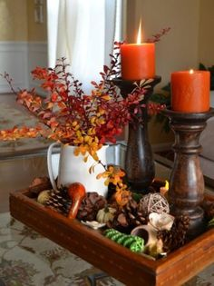 I like this idea for a fall centerpiece. collect pinecones, acorns, nuts, and put them in a tray or clear glass bowl.