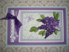 Lilac card made from clusters of tiny punched flowers.