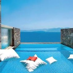 Hammock over infinity pool at Domes of Elounda spa resort in Crete.