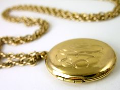 vintage locket necklace w/ my initials added charms like rosewood, jade, onyx...inside pic of my mom & dad...think I got it when I was 15 yrs old from my high school sweetheart.