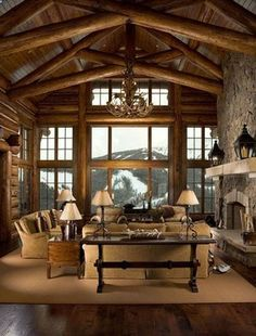 That view! Gorgeous! But yet again the inside is just as gorgeous. The over-sized wooden beams, wood.....everywhere! Can't miss the grey stone fireplace...definitely sticks out from the natural color of the wood. Every little detail counts. Name some other details you see! www.arnoldmasonry... #Home #Renovation #Contractor #Company #Alpharetta #Georgia #Home_Renovation_Contractor_Company_Alpharetta_Georgia