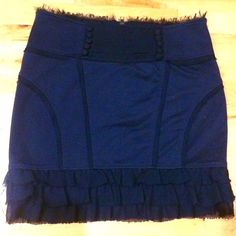 "❗️️SALE❗️Navy skirt with edgy detailing. RARE. From Forever 21's discontinued higher quality line ""Twelve by Twelve LA"". This skirt comes with  accentuating seams baring raw chiffon, an exposed zip, decorative cloth covered Victorian buttons and ruffles. Worn. Few times but in great condition.    15"" waist, 18.5"" hip and 17"" length when laid flat.  Primary fabric is a nice thick jersey but it does have some stretch.  Skirt is lined. All items are steamed before being sent out. Forever 21…"