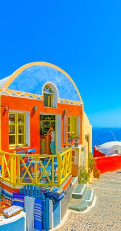 Typical colorful narrow street in Oia the most beautiful village of Santorini island in Greece | 10 Breathtaking Photos of World's Most Romantic Island