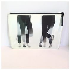 Kate Spade Georgie Dancing Feet Clutch This great clutch features black and white holographic legs that dance when you move it. Zip top with a black zipper pull. Lenticular fabric with patent faux leather trim. Lined interior. kate spade Bags Clutches & Wristlets