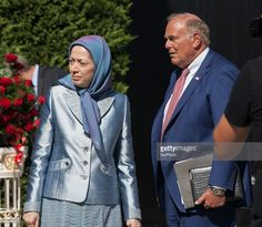 Maryam Rajavi(R) and Ed Rendell(L), chairman of the 2016 U.S. Democratic National Convention, speak at the conference Justice for victims  of 1988 Massacre, at the headquarters of the National Council of Resistance of Iran in Auvers-sur-Oise.